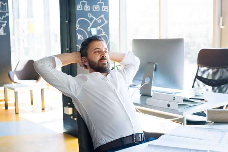 businessman-at-the-desk-in-his-office-having