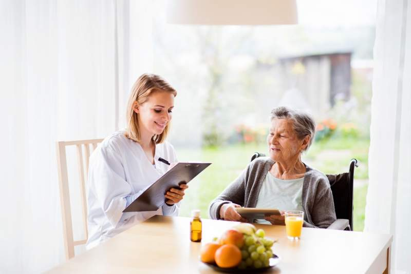 health-visitor-and-a-senior-woman-with-tablet