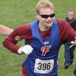 Runner praised for helping legally blind competitor who fell