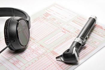 audiogram, otoscope and headphones for hearing testing