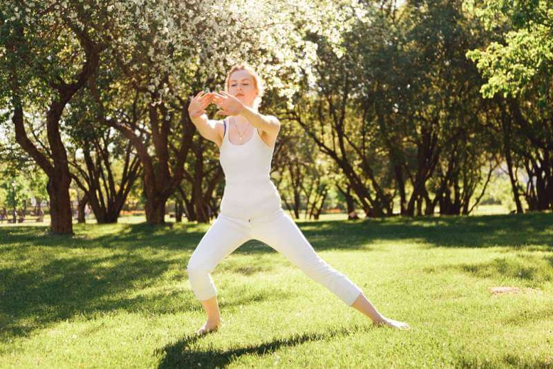 young-female-doing-exercises-at-the-park