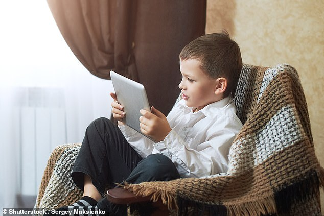 Almost one in five three to four-year-olds (19 per cent) in the UK have a tablet, according to research by communications regulator Ofcom (stock image)