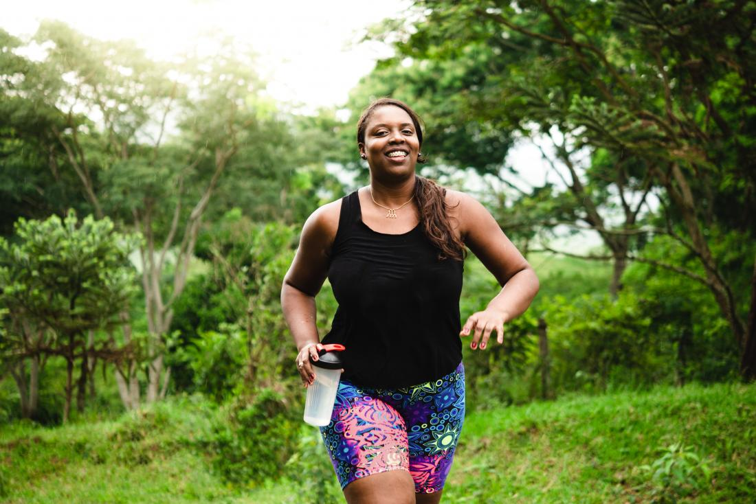 Woman jogging or running to lose weight and stay fit
