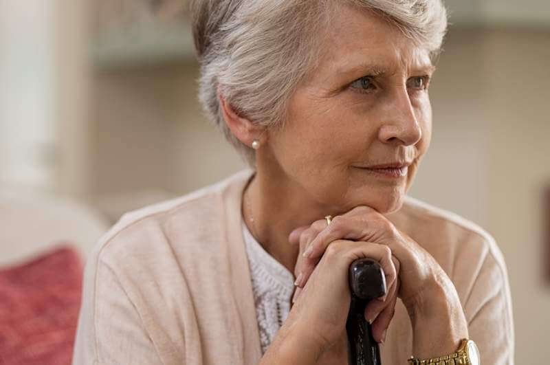 senior-woman-holding-cane