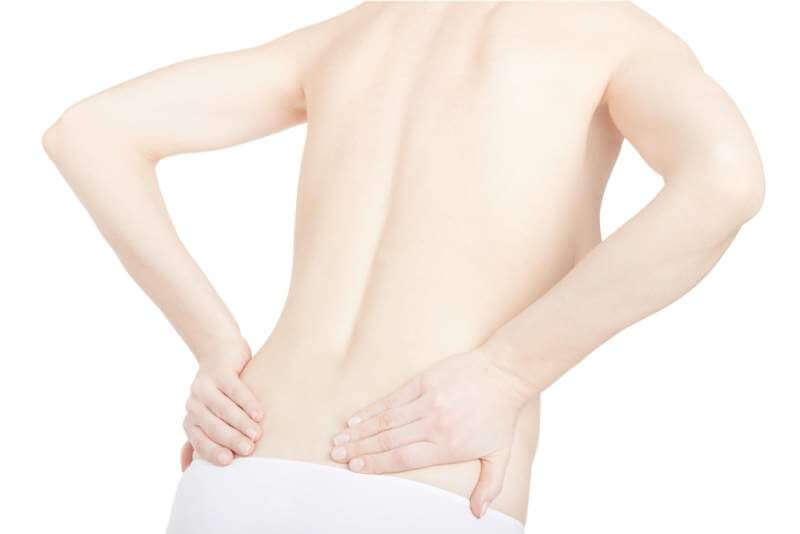 young-adult-woman-with-back-pain-isolated